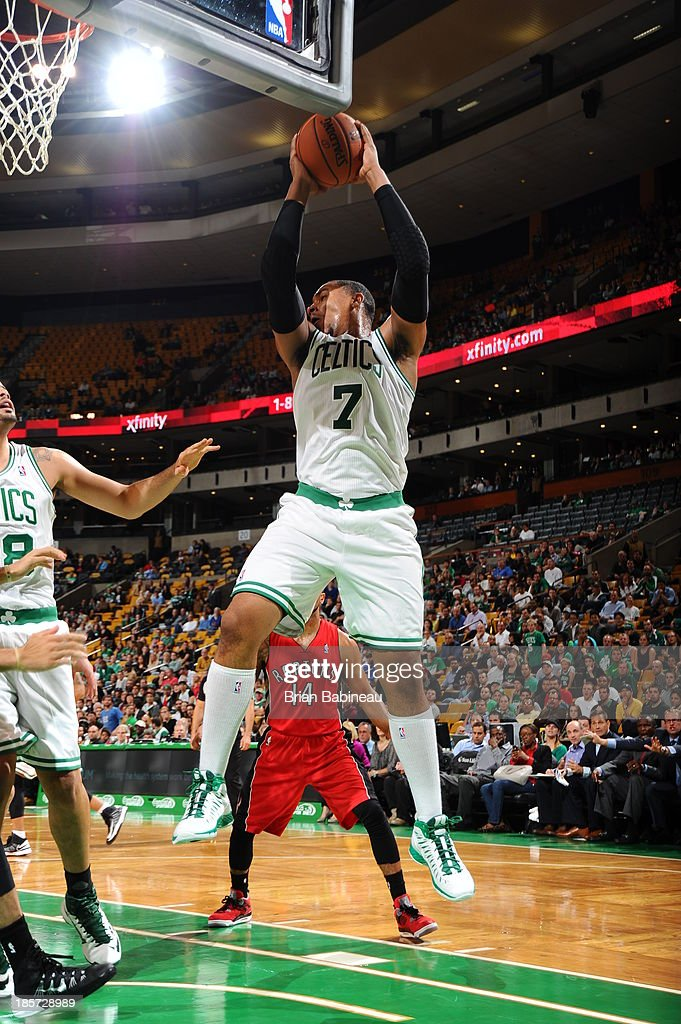 Jared Sullinger #7 of the Boston Celtics grabs a rebound against the Toronto Raptors on October 7, 2013 at the TD Garden in Boston, Massachusetts.