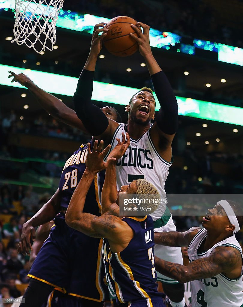 Jared Sullinger #7 of the Boston Celtics grabs a rebound over Ian Mahinmi #28 of the Indiana Pacers during the fourth quarter at TD Garden on November 11, 2015 in Boston, Massachusetts.