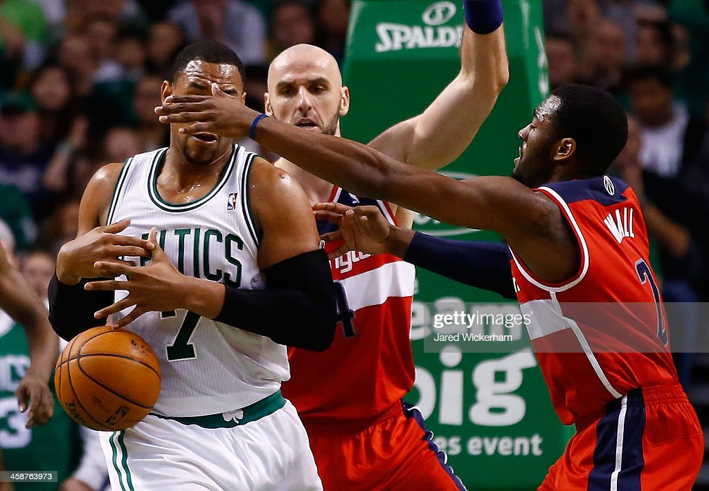 Jared Sullinger #7 of the Boston Celtics loses the ball underneath the basket in the fourth quarter in front of John Wall #2 of the Washington Wizards during the game at TD Garden on December 21, 2013 in Boston, Massachusetts.