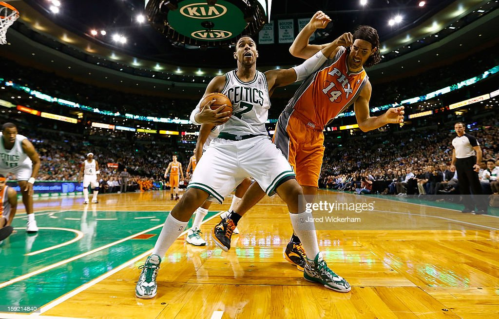 Jared Sullinger #7 of the Boston Celtics protects the ball after pulling in a rebound in front of Luis Scola #14 of the Phoenix Suns during the game on January 9, 2013 at TD Garden in Boston, Massachusetts.