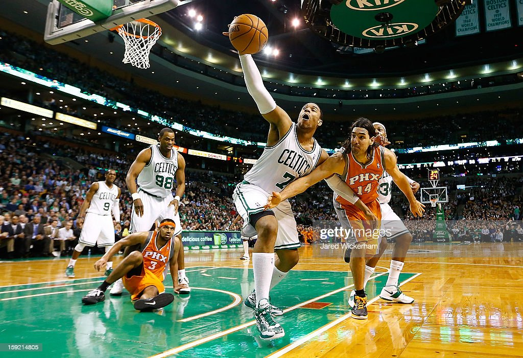 Jared Sullinger #7 of the Boston Celtics pulls in a rebound in front of Luis Scola #14 of the Phoenix Suns during the game on January 9, 2013 at TD Garden in Boston, Massachusetts.