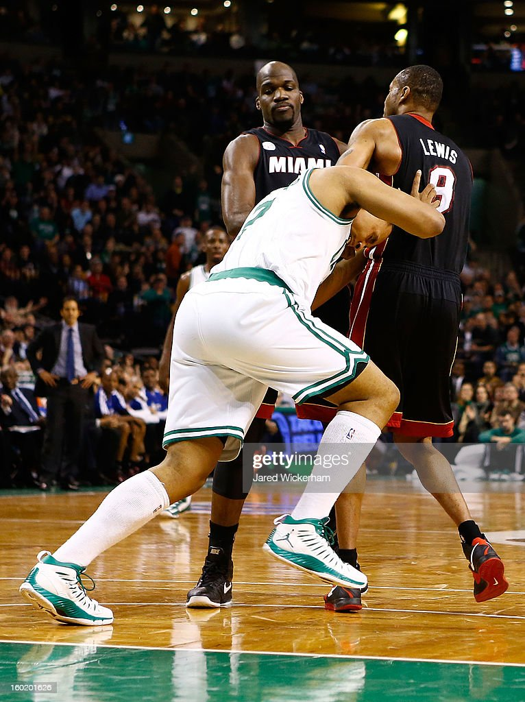 Jared Sullinger #7 of the Boston Celtics pushes Rashard Lewis #9 of the Miami Heat after the two got tangled up on an in-bounds pass during the game on January 27, 2013 at TD Garden in Boston, Massachusetts. Both players would be issued technical fouls.