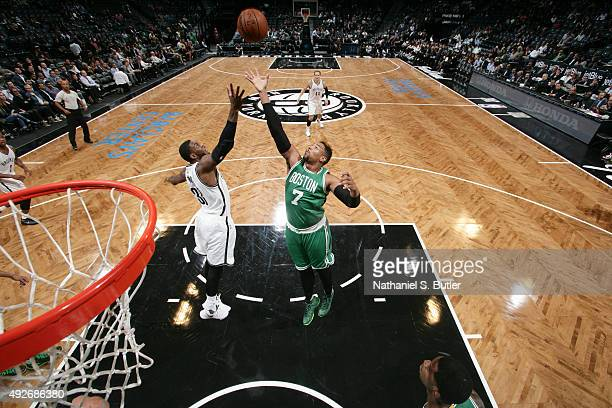 Jared Sullinger of the Boston Celtics reaches for the ball against Willie Reed of the Brooklyn Nets during the preseason game on October 14 2015 at...