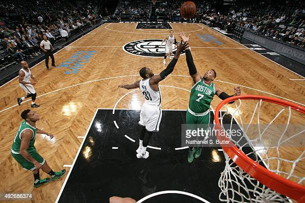 Jared Sullinger of the Boston Celtics reaches for the rebound against Willie Reed of the Brooklyn Nets during the preseason game on October 14 2015...