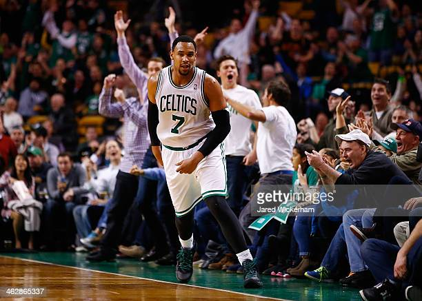 Jared Sullinger of the Boston Celtics reacts following a three point shot to end the third quarter against the Toronto Raptors during the game at TD...