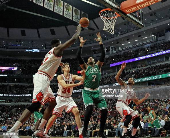 Jared Sullinger of the Boston Celtics rebounds surrounded by Nazr Mohammed Mike Dunleavy and DJ Augustin of the Chicago Bulls at the United Center on...