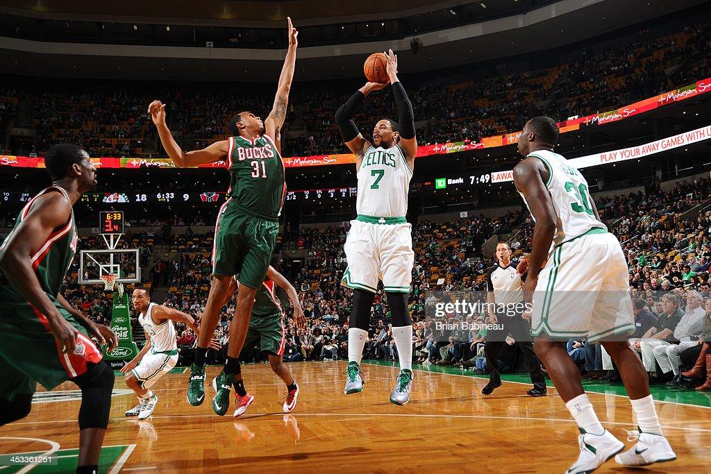 Jared Sullinger #7 of the Boston Celtics shoots against John Henson #31 of the Milwaukee Bucks on December 3, 2013 at the TD Garden in Boston, Massachusetts.