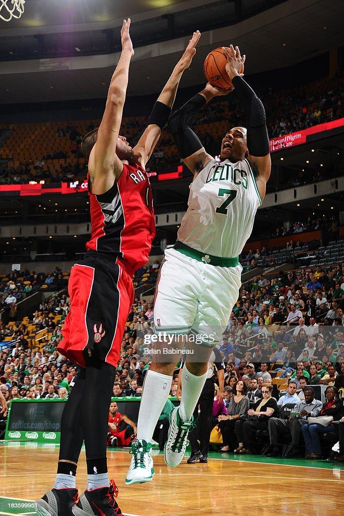 Jared Sullinger #7 of the Boston Celtics shoots the ball against the Toronto Raptors on October 7, 2013 at the TD Garden in Boston, Massachusetts.