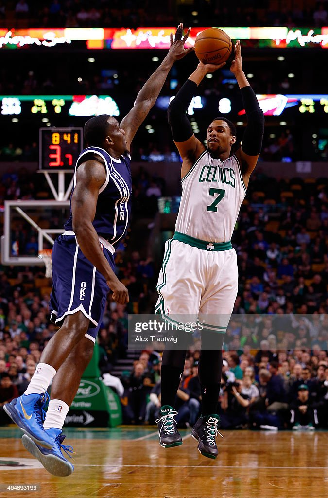 Jared Sullinger #7 of the Boston Celtics takes a shot over Kendrick Perkins #5 of the Oklahoma City Thunder during a game at the TD Garden on January 24, 2014 in Boston, Massachusetts.