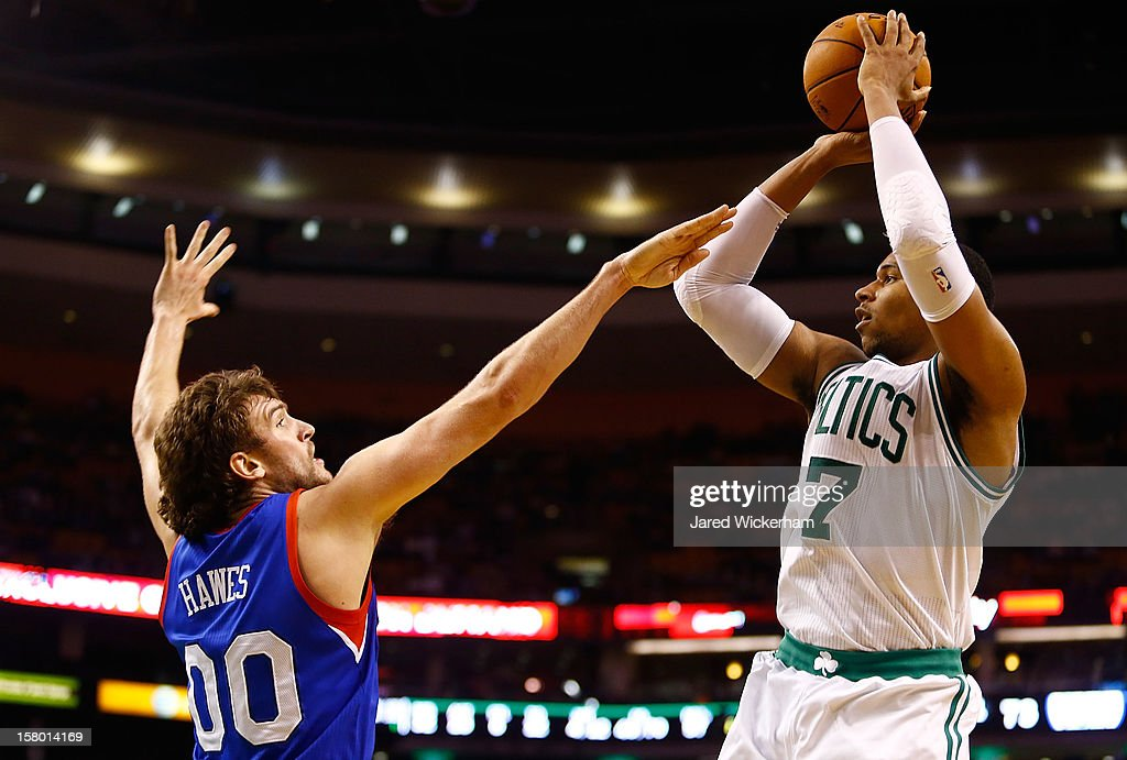 Jared Sullinger #7 of the Boston Celtics takes a shot over Spencer Hawes #00 of the Philadelphia 76ers during the game on December 8, 2012 at TD Garden in Boston, Massachusetts.