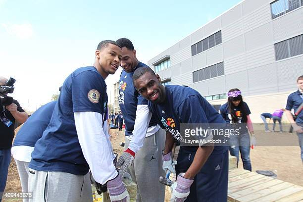 Jared Sullinger of the Boston Celtics Tim Hardaway Jr of the New York Knicks and Trey Burke of the Utah Jazz help build during the NBA Cares AllStar...
