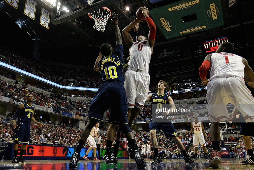 Jared Sullinger of the Ohio State Buckeyes attempts a shot in the first half against Tim Hardaway Jr #10 of the Michigan Wolverines during the...