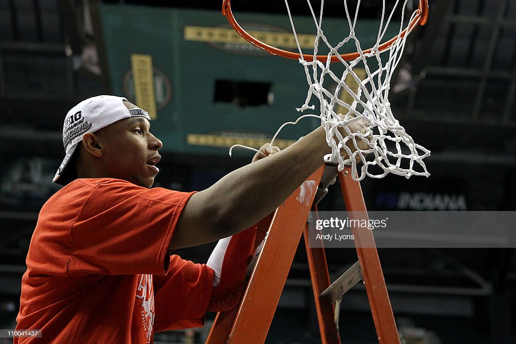 <a gi-track='captionPersonalityLinkClicked' href=/galleries/search?phrase=Jared+Sullinger&family=editorial&specificpeople=6866665 ng-click='$event.stopPropagation()'>Jared Sullinger</a> #0 of the Ohio State Buckeyes cuts down a piece of the net in celebration of their 71-60 win against the Penn State Nittany Lions during the championship game of the 2011 Big Ten Men's Basketball Tournament at Conseco Fieldhouse on March 13, 2011 in Indianapolis, Indiana.