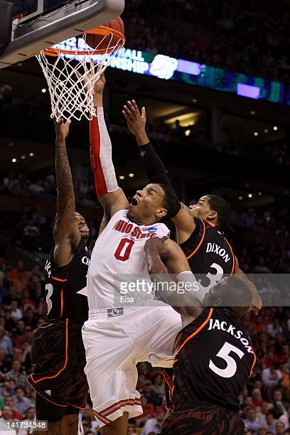 Jared Sullinger of the Ohio State Buckeyes goes the basket against Sean Kilpatrick Dion Dixon and Justin Jackson of the Cincinnati Bearcats during...