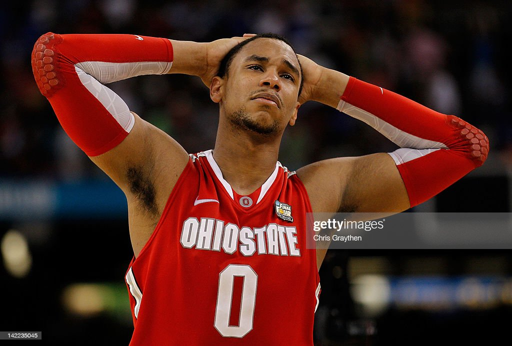 <a gi-track='captionPersonalityLinkClicked' href=/galleries/search?phrase=Jared+Sullinger&family=editorial&specificpeople=6866665 ng-click='$event.stopPropagation()'>Jared Sullinger</a> #0 of the Ohio State Buckeyes reacts after the Buckeyes lose to the Kansas Jayhawks 64-62 during the National Semifinal game of the 2012 NCAA Division I Men's Basketball Championship at the Mercedes-Benz Superdome on March 31, 2012 in New Orleans, Louisiana.