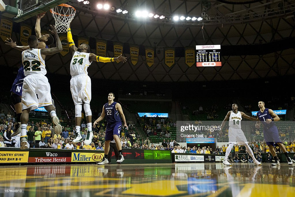 Jared Swopshire #12 of the Northwestern University Wildcats makes a reverse layup against the Baylor University Bears on December 4, 2012 at the Ferrell Center in Waco, Texas.