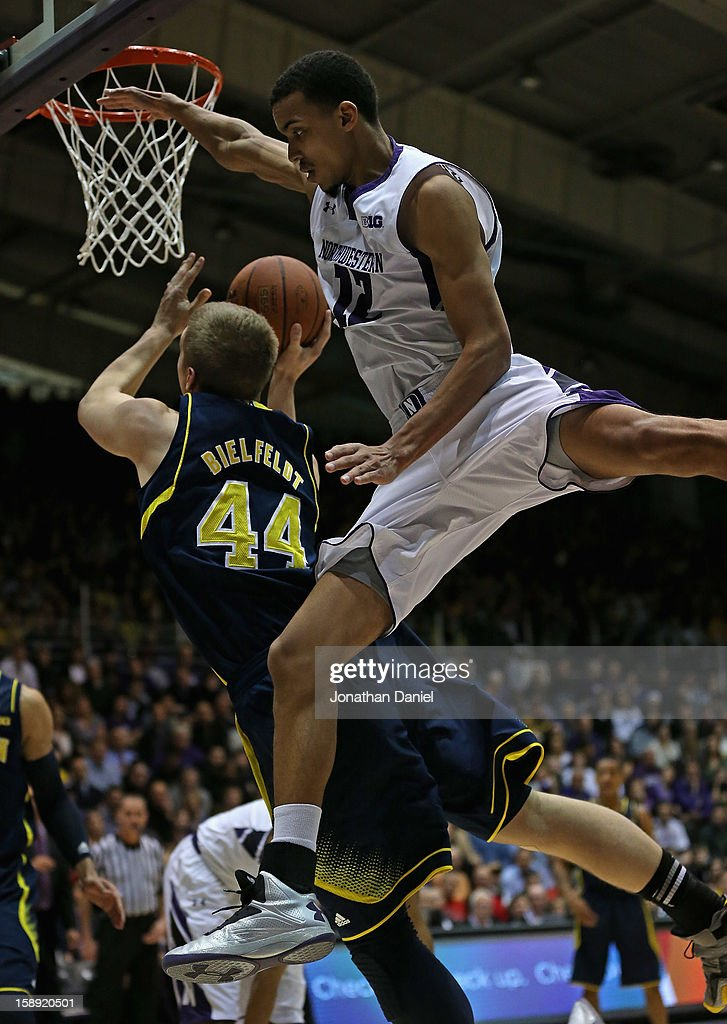 Jared Swopshire #12 of the Northwestern Wildcats fouls Max Bielfeldt #44 of the Michigan Wolverines at Welsh-Ryan Arena on January 3, 2013 in Evanston, Illinois. Michigan defeated Northwestern 94-66.
