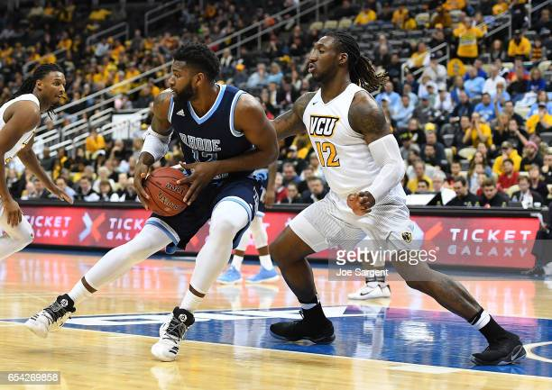 Jared Terrell of the Rhode Island Rams battles for position against Mo AlieCox of the Virginia Commonwealth Rams during the championship game of the...