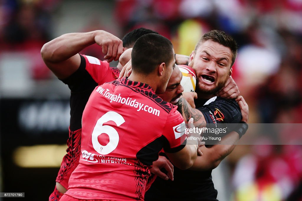 Jared Waerea-Hargreaves of the Kiwis is tackled by Tuimoala Lolohea of Tonga during the 2017 Rugby League World Cup match between the New Zealand Kiwis and Tonga at Waikato Stadium on November 11, 2017 in Hamilton, New Zealand.