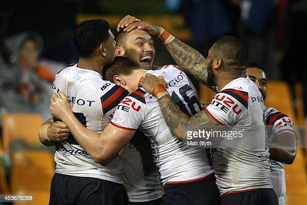 Jared WaereaHargreaves of the Roosters celebrates scoring a try during the round 23 NRL match between the Wests Tigers and the Sydney Roosters at...