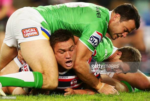Jared WaereaHargreaves of the Roosters is tackled during the round 12 NRL match between the Sydney Roosters and the Canberra Raiders at Allianz...