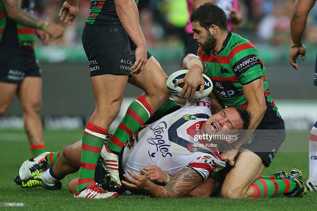 Jared Waerea-Hargreaves of the Roosters is tackled during the round 26 NRL match between the South Sydney Rabbitohs and the Sydney Roosters at ANZ Stadium on September 6, 2013 in Sydney, Australia.