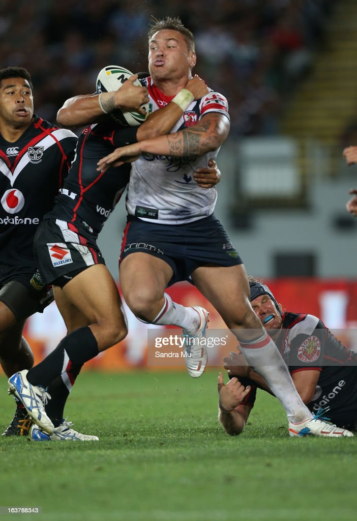 Jared Waerea-Hargreaves of the Roosters is tackled during the round two NRL match between the New Zealand Warriors and the Sydney Roosters at Eden Park on March 16, 2013 in Auckland, New Zealand.