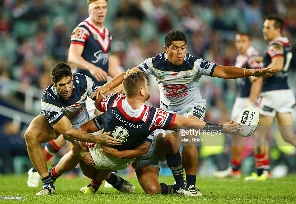 Jared Waerea-Hargreaves of the Roosters offloads during the round 23 NRL match between the Sydney Roosters and the North Queensland Cowboys at Allianz Stadium on August 14, 2016 in Sydney, Australia.