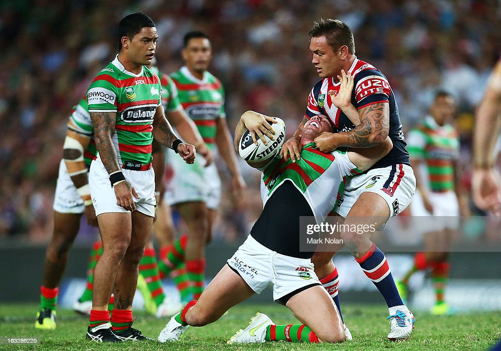 Jared Waerea-Hargreaves of the Roosters tackles Chris McQueen of the Rabbioths during the round one NRL match between the Sydney Roosters and the South Sydney Rabbitohs at Allianz Stadium on March 7, 2013 in Sydney, Australia.