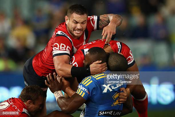 Jared WaereaHargreaves of the Roosters tackles Semi Radradra of the Eels during the round 18 NRL match between the Parramatta Eels and the Sydney...