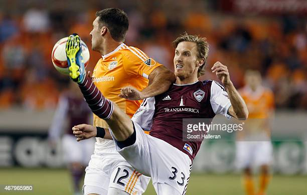 Jared Watts of the Colorado Rapids battles for the ball with Will Bruin of the Houston Dynamo during their game at BBVA Compass Stadium on March 28...