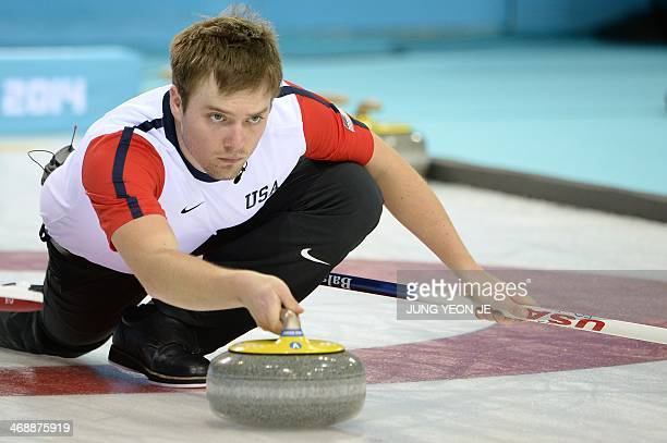 Jared Zezel of the USA throws the stone during the 2014 Sochi winter olympics men's curling round robin session 4 match against Switzerland at the...