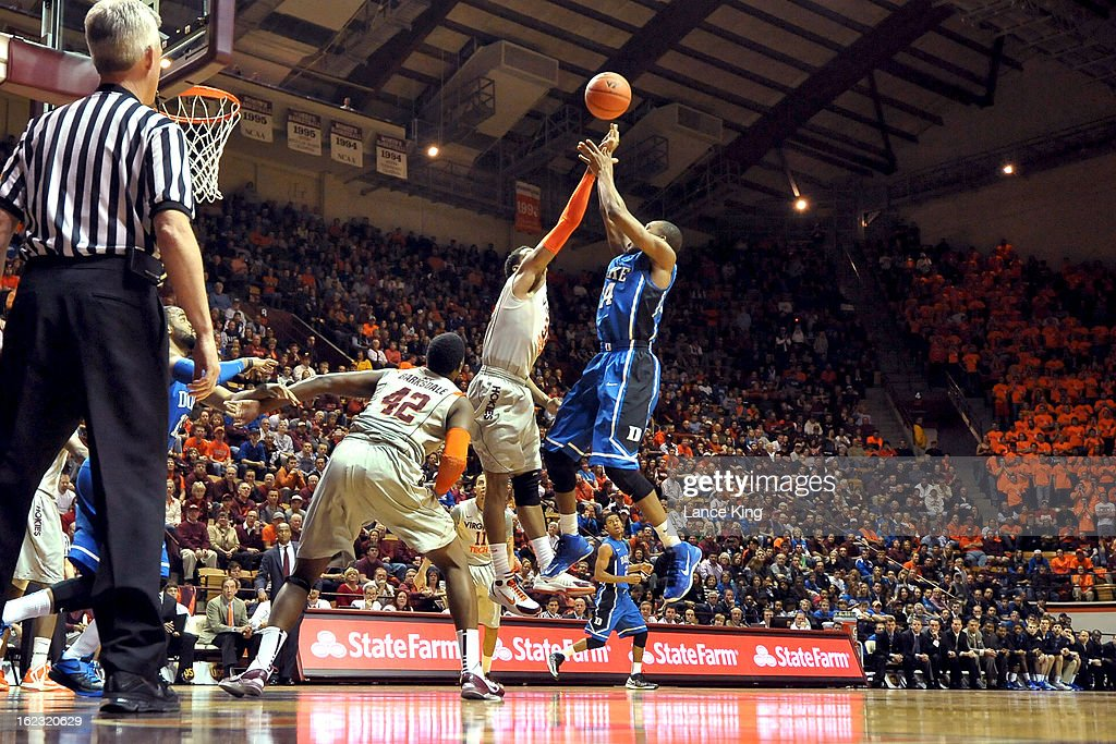 Jarell Eddie #31 of the Virginia Tech Hokies blocks a shot by Rasheed Sulaimon #14 of the Duke Blue Devils at Cassell Coliseum on February 21, 2013 in Blacksburg, Virginia.