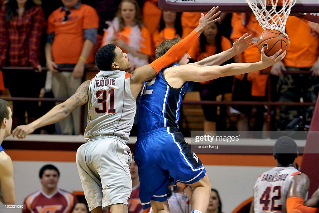 Jarell Eddie #31 of the Virginia Tech Hokies defends a shot by Alex Murphy #12 of the Duke Blue Devils at Cassell Coliseum on February 21, 2013 in Blacksburg, Virginia. Duke defeated Virginia Tech 88-56.