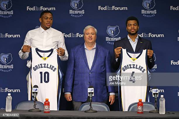 Jarell Martin Andrew Harrison and General Manager Chris Wallace of the Memphis Grizzlies address the media during a press conference introducing 2015...