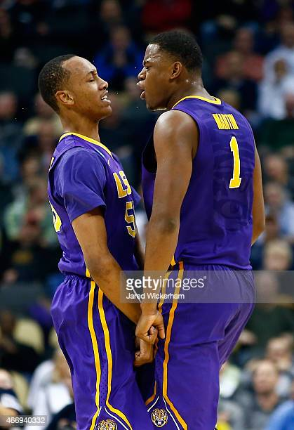 Jarell Martin of the LSU Tigers reacts with teammate Tim Quarterman after a play against the North Carolina State Wolfpack in the first half during...