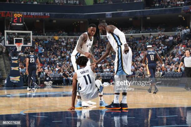 Jarell Martin of the Memphis Grizzlies helps up teammate Mike Conley during the game against the New Orleans Pelicans during the 201718 regular...