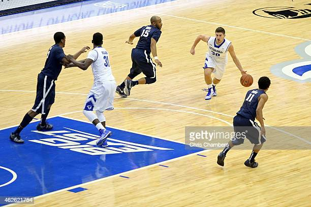 Jaren Sina of the Seton Hall Pirates drives against the Xavier Musketeers during their Big East conference regular season game at Prudential Center...