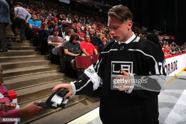 Jaret AndersonDolan puts on the Los Angeles Kings jersey after being selected 41st overall during the 2017 NHL Draft at the United Center on June 24...