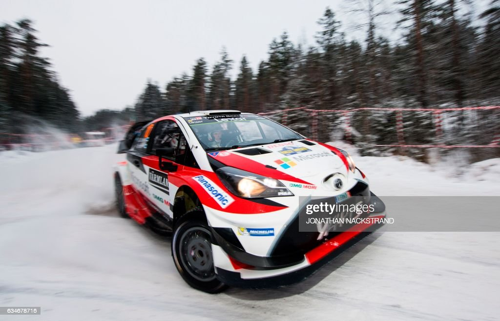 TOPSHOT - Jari Matti Latvala of Finland and his co-driver Miikka Anttila compete in their Toyota Yaris WRC during the 9th stage of the Rally Sweden, second round of the FIA World Rally Championship on February 11, 2017 in Knon near Hagfors, Sweden. / AFP PHOTO / Jonathan NACKSTRAND