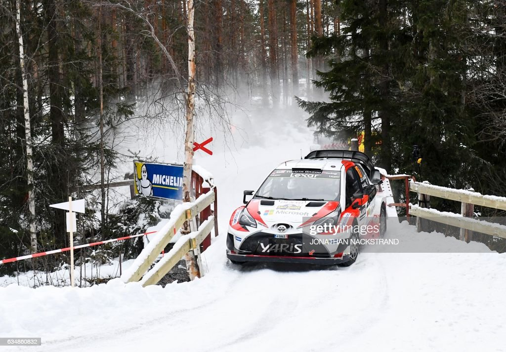 Jari Matti Latvala of Finland and his co-driver Miikka Anttila compete in their Toyota Yaris WRC during the 17th stage of the Rally Sweden, second round of the FIA World Rally Championship on February 12, 2017 in Likenas, Sweden. / AFP / Jonathan NACKSTRAND