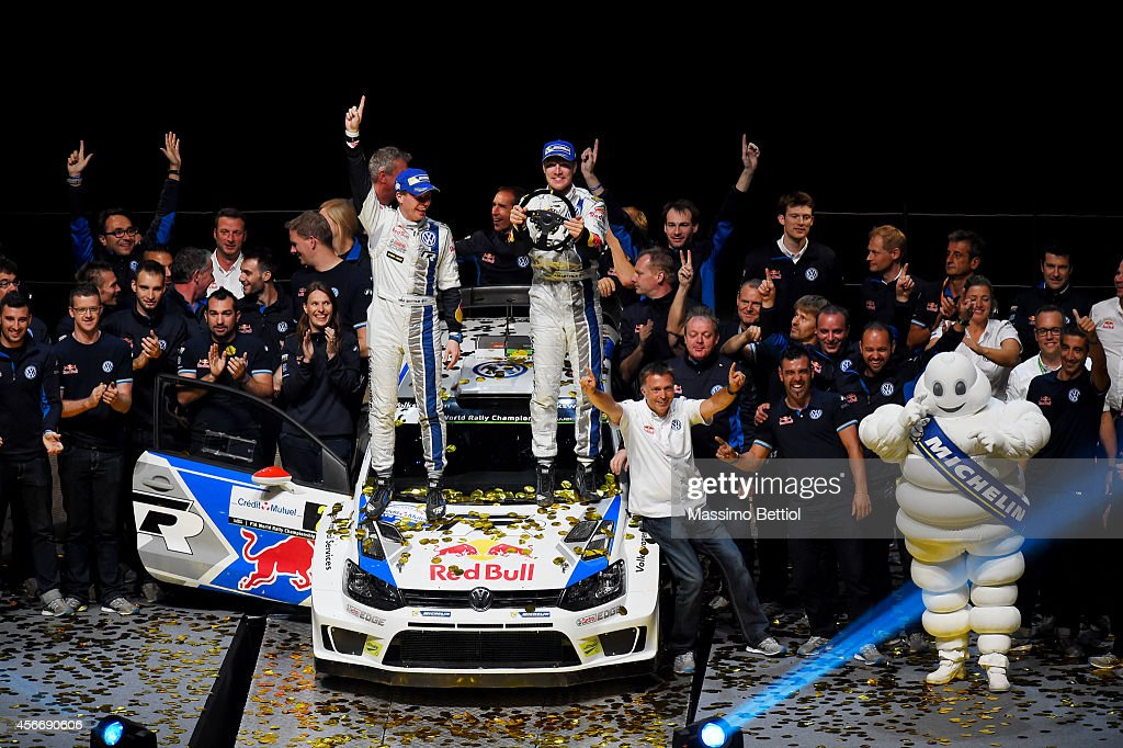 Jari Matti Latvala of Finland and Mikka Anttila of Finland celebrate their victory in the final podium of Strasbourg during Day Three of the WRC France on October 5, 2014 in Strasbourg, France.