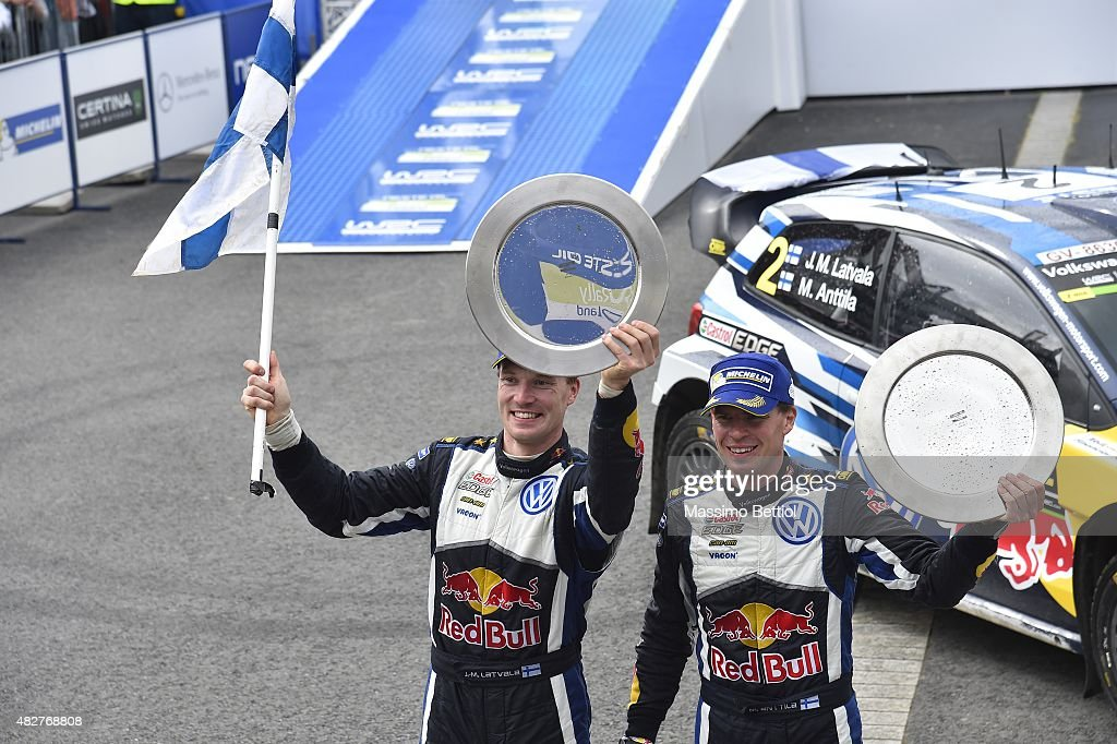 Jari Matti Latvala of Finland and Mikka Anttila of Finland celebrate their victory during Day Three of the WRC Finland on August 2, 2015 in Jyvaskyla, Finland.