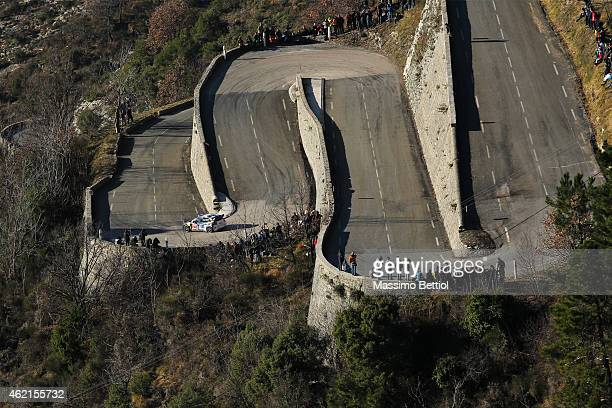 Jari Matti Latvala of Finland and Mikka Anttila of Finland compete in their Volkswagen Motorsport Polo R WRC during Day Four of the WRC Montecarlo on...
