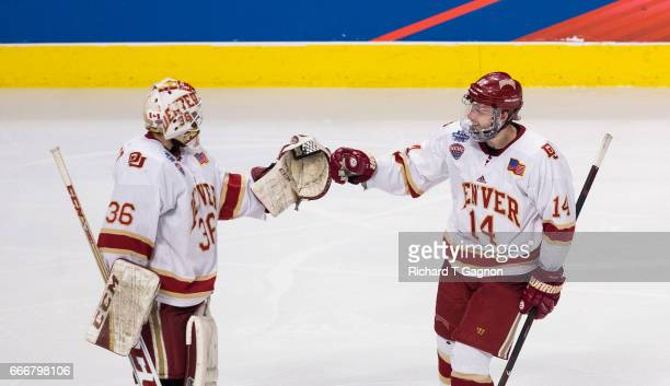 Jarid Lukosevicius of the Denver Pioneers celebrates his first of three goals against the Minnesota Duluth Bulldogs with teammate Tanner Jaillet...