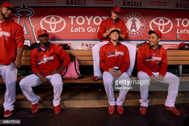 Jario Diaz Yoslan Herrera Mike Morin Michael Roth and Fernando Salas of the Los Angeles Angels of Anaheim joke in the dugout before the game against...