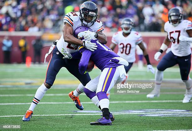 Jarius Wright of the Minnesota Vikings gets tackled by Ryan Mundy of the Chicago Bears during the second quarter on December 28 2014 at TCF Bank...