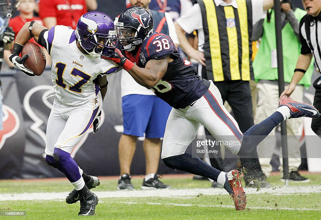 Jarius Wright #17 of the Minnesota Vikings us grabbed by his face mask by <a gi-track='captionPersonalityLinkClicked' href=/galleries/search?phrase=Danieal+Manning+-+American+Football+Player&family=editorial&specificpeople=589817 ng-click='$event.stopPropagation()'>Danieal Manning</a> #38 of the Houston Texans in the fourth quarter at Reliant Stadium on December 23, 2012 in Houston, Texas. Minnesota Vikings defeat the Houston Texans 23-6.