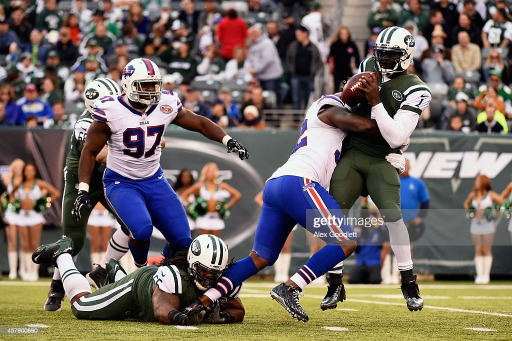 Jarius Wynn #92 of the Buffalo Bills sacks quarterback Michael Vick #1 of the New York Jets in the fourth quarter at MetLife Stadium on October 26, 2014 in East Rutherford, New Jersey.