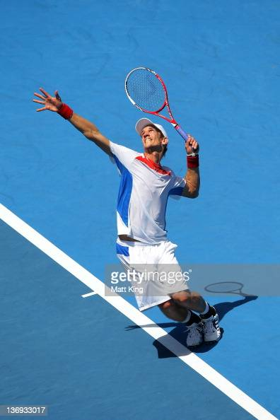 Jarkko Nieminen of Finalnd serves in his semi final match against Denis Istomin of Uzbekistan during day six of the 2012 Sydney International at...